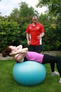 Using the swiss ball to perform crunches - great core exercise